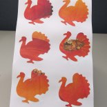 Cutout turkeys silhouettes from decorative scrapbook paper using a paper punch. By Sharon Orrick (New Jersey).