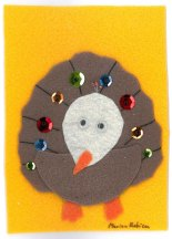 Glued felt with sequins by Marion Robinson, Minnesota.